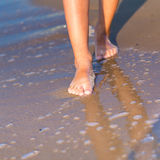 Child walking with bare feet along the seashore Royalty Free Stock Photography