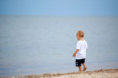 Child walking on the beach Royalty Free Stock Images
