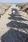 Child walking on the beach Stock Photo