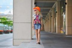 Child walking in big mall along window displays Stock Photo