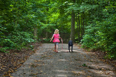 Child Walking Dog Stock Photos