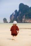Child walking on fine sand Stock Photo