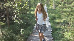 Child Walking in Forest, Kid Outdoor Nature, Girl Playing in Camping Adventure royalty free stock photos