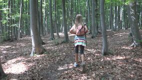 Child Walking in Forest, Kid Outdoor Nature, Girl Playing in Camping Adventure royalty free stock photography