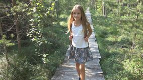 Child Walking in Forest, Kid Outdoor Nature, Girl Playing in Camping Adventure royalty free stock image
