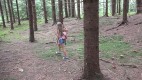 Child Walking in Forest, Kid Outdoor Nature, Girl Playing in Camping Adventure royalty free stock photo