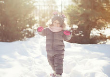 Child walking in the forest, winter day Stock Photos