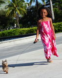 Child Walking Her Dog Stock Photography