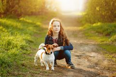 Cute girl walking her puppy. Stock Photo