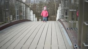 Child walking. Little cute child walking on the bridge stock video footage