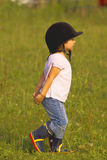 Child walking in the meadow Royalty Free Stock Photo