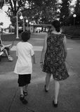 Child walking with mother Stock Images