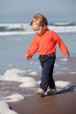 Child walking by the ocean Stock Image