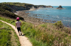 Child walking on a path over the sea. Stock Images