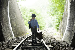 Child walking on railway road Royalty Free Stock Images