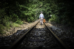 Child walking on railway Royalty Free Stock Photos