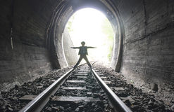 Child walking in railway tunnel Stock Photo