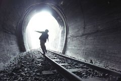 Child walking in railway tunnel Stock Images