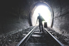 Child walking in railway tunnel Royalty Free Stock Image