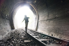 Child walking in railway tunnel Stock Photos