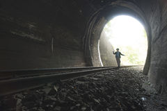 Child walking in railway tunnel Royalty Free Stock Photos