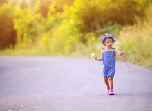 Child walking on the road Royalty Free Stock Photos