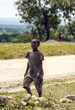 Child, walking in road Stock Photo