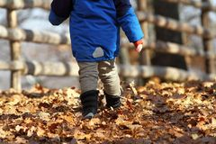 Child walking on rural road Royalty Free Stock Photos