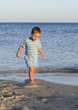 Child walking on sand beach Royalty Free Stock Photography