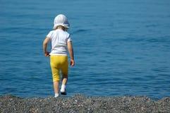 Child walking on seaside Royalty Free Stock Photography