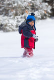 Child walking on snow Stock Images