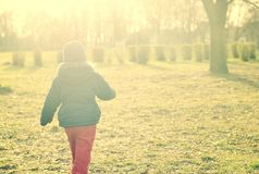 Child walking in sunlight. Royalty Free Stock Photo