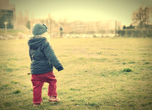 Child walking in sunlight. Royalty Free Stock Photos