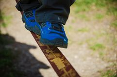 Child walking on a tightrope stock photos