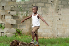 Child walking on a tree trunk. Royalty Free Stock Image