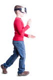 Child walking with virtual reality headset on Royalty Free Stock Photo