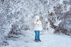 Child walking in winter forest Royalty Free Stock Images