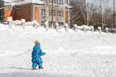 A child walks alone in the Park on a winter day royalty free stock photography