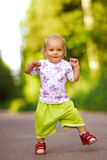 Child walks on road. The little girl vigorously goes on asphalted path Stock Photography