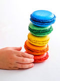 Child wants to take macaroons Stock Photos