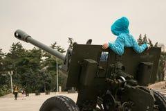 Child on war machine. Child relaxing on war machine royalty free stock photo