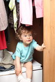 Child in wardrobe Royalty Free Stock Photography