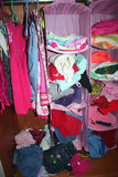 A child wardrobe. Mixed child wardrobe with full of clothes Royalty Free Stock Images