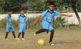 A child was practicing football. In one of the football schools in the area Sukoharjo central java Indonesia , many local football school that spawned national royalty free stock photo