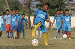 A child was practicing football. In one of the football schools in the area Sukoharjo central java Indonesia , many local football school that spawned national stock photography
