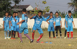 A child was practicing football. In one of the football schools in the area Sukoharjo central java Indonesia , many local football school that spawned national stock images
