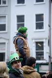 The child was standing on the high place on St. Patrick`s Day Parade in Dublin, Ireland, March 18th 2015 Royalty Free Stock Image