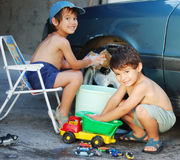 Child washing car Stock Images