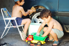 Child washing car and toy car Royalty Free Stock Photo