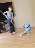 Child washing floor Stock Image